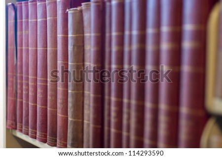 Many books on a shelf in a Library