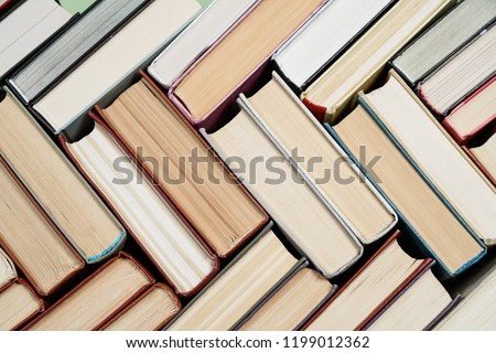 Many Books Piles. Hardback books on wooden table. Back to school. Copy space #1199012362