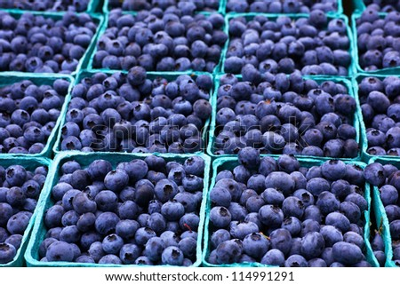Many boxes of blueberries with soft background at the Farmers Market