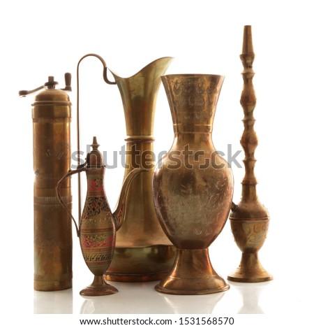 many brass objects on a white background