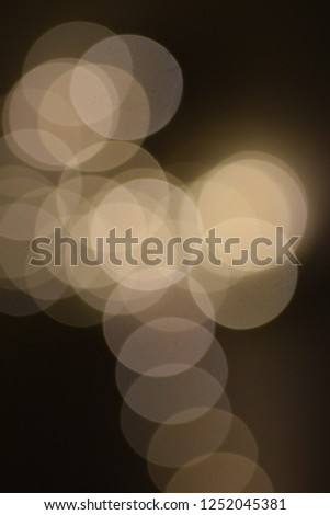 many bright blurry circles overlapping against dark background, design element #1252045381