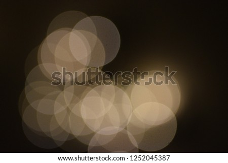 many bright blurry circles overlapping against dark background, design element #1252045387