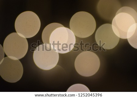 many bright blurry circles overlapping against dark background, design element #1252045396
