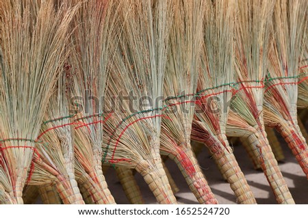 Many brooms were laid out together
