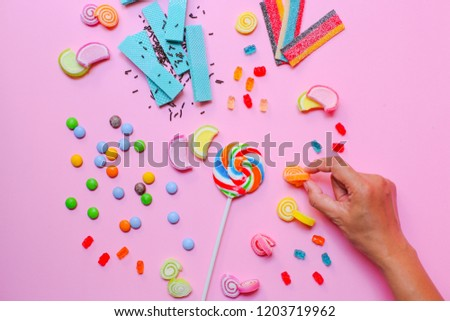 Many Candy's With Pink Background
