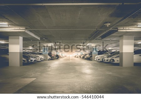 many cars in parking garage...