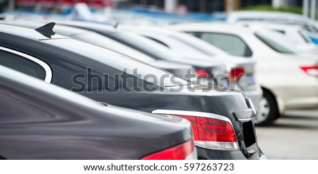 many cars parked in a row.  #597263723