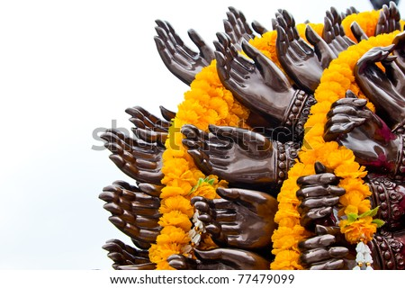 Many cast bronze hands of god Ganesha with yellow garland,Wat Samarn,Chacheangsoa,Thailand.