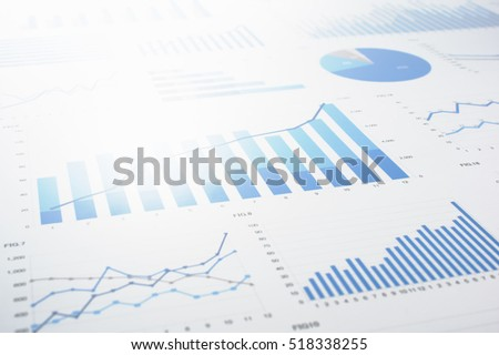 Many charts and graphs. Reflection light and flare. Concept image of data gathering and statistical working.