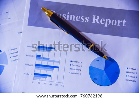 Many charts and graphs with magnifying glass and many pencil. Reflection light and flare. Concept image of data gathering and statistical working. #760762198