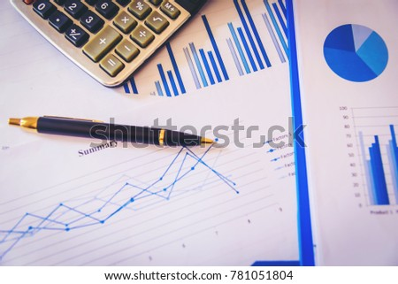Many charts and graphs with magnifying glass and many pencil. Reflection light and flare. Concept image of data gathering and statistical working. #781051804