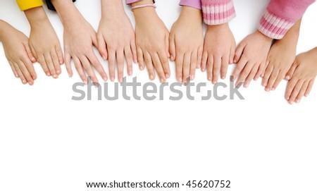 Many children hands on white