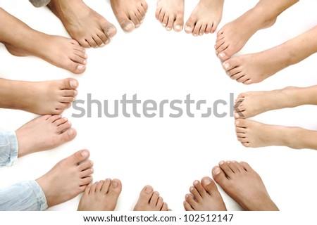 Many children legs on white