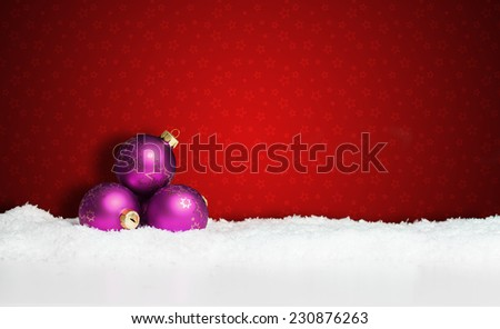 many christmas balls in the snow