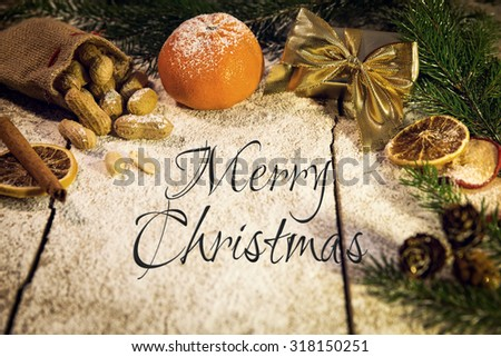 many christmas fruits on a sugared table, merry christmas