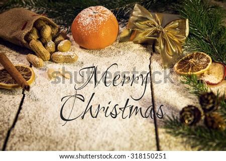many christmas fruits on a sugared table, merry christmas