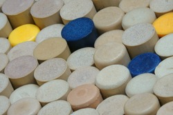 Many clean and logo-free synthetic wine corks are shown standing on display in a diagonal view.
