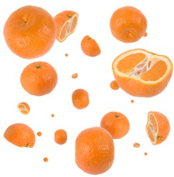 Many clementines freefalling in mid air on white background. Selective focus - shallow depth of field.