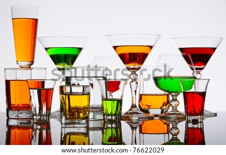 Many cocktails - wine glasses with various alcoholic beverages
