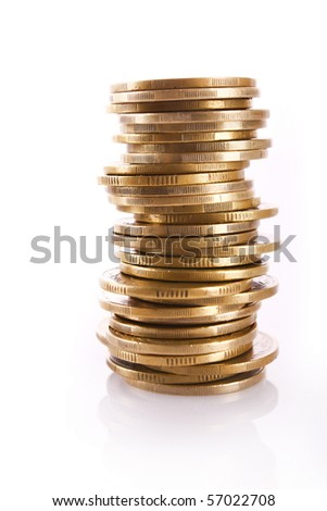 Many coins in column isolated on white