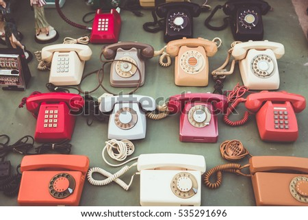 Many collection old telephone in vintage market