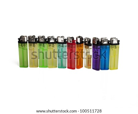 Many color lighters stand in line isolated on white background