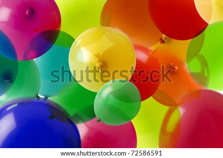 many colored balloons forming a bright background wallpaper image - stock photo