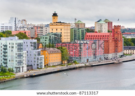 many-colored buildings on waterfront of Saltsjon bay in Stockholm - stock photo