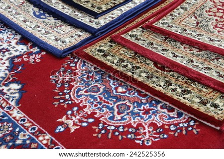 many colored carpets decorated in a mosque