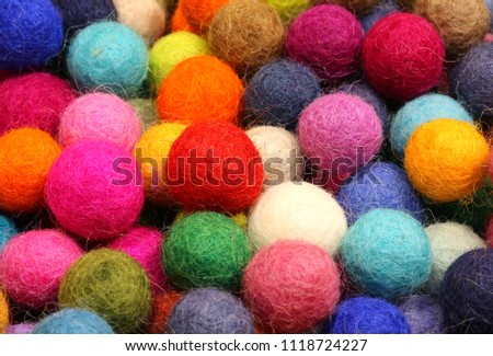 Many colored felt balls forming a background #1118724227