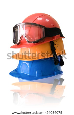 Many colored hardhats and goggles on white