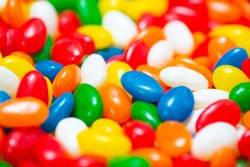 many colored jelly beans red white green blue orange yellow close up with copy space