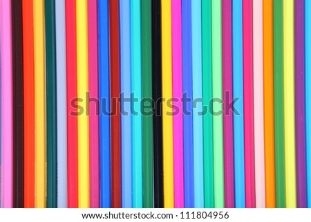 Many-colored pencils close-up, background
