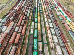 Many colorful and rusty wagons