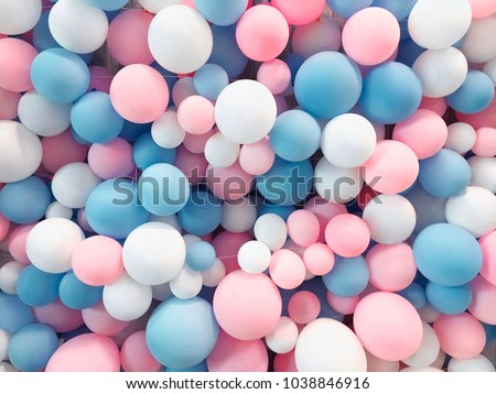 Many colorful balloons decorated wall as background - Shutterstock ID 1038846916
