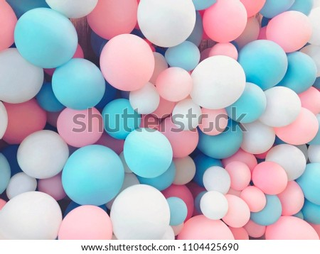 Many colorful balloons decorated wall as background
