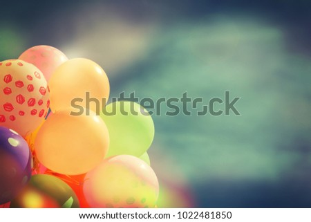 Many colorful balloons in the blue sky.