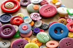Many colorful garment buttons in various shapes and sizes