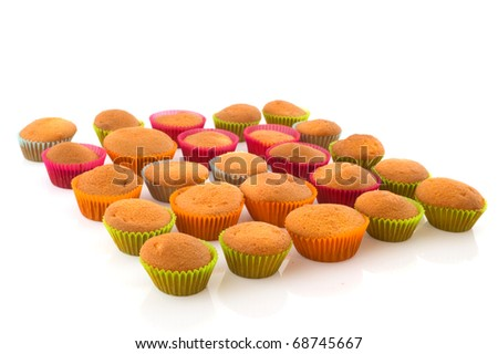 Many colorful home made cup cakes isolated over white