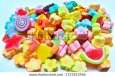 Many colorful lollipops with a sweet flavor placed on the plate.