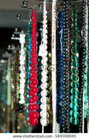 Many colorful Oriental beads and necklaces over the counter in the market #584500045