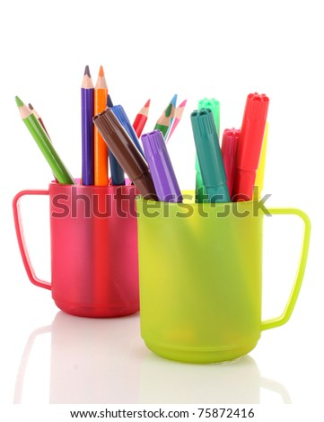 Many colorful pencils in the cup  on the white background