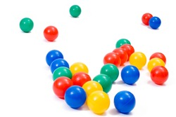 Many colorful plastic toy balls on white