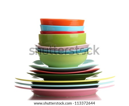 Many colorful plates isolated on white