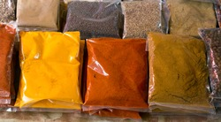 Many colorful spice bags at market in Seychelles