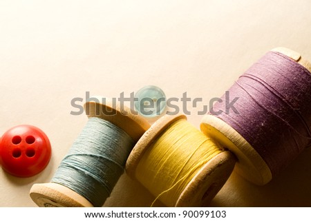 Many-coloured buttons and bobbins
