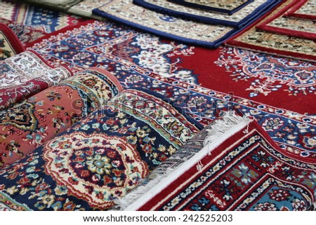 many colourful Oriental rugs for sale in the shop of rugs