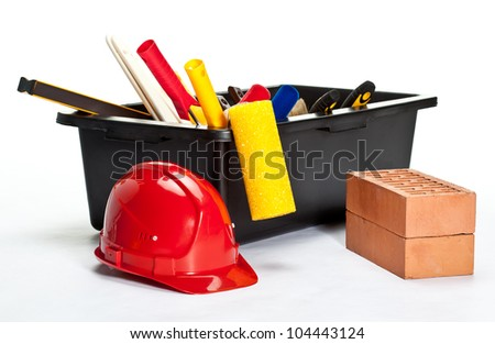 Many construction tools inside a container, hardhat and bricks on white background