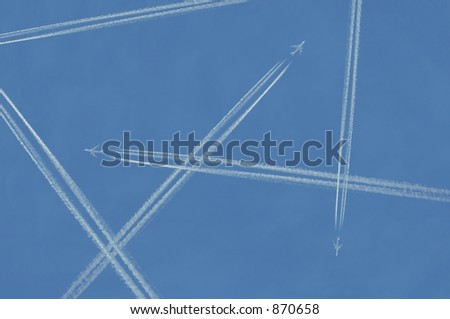 Many contrails made by jets in the sky. - stock photo