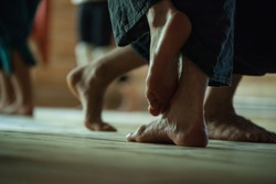 many dancers foots on floor, on blurred background
